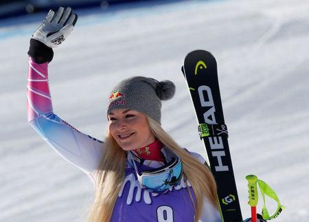 Skiing - Alpine Skiing World Cup - Women's Downhill - Cortina d'Ampezzo, Italy - January 20, 2018. Lindsey Vonn celebrates her first place. REUTERS/Stefano Rellandini