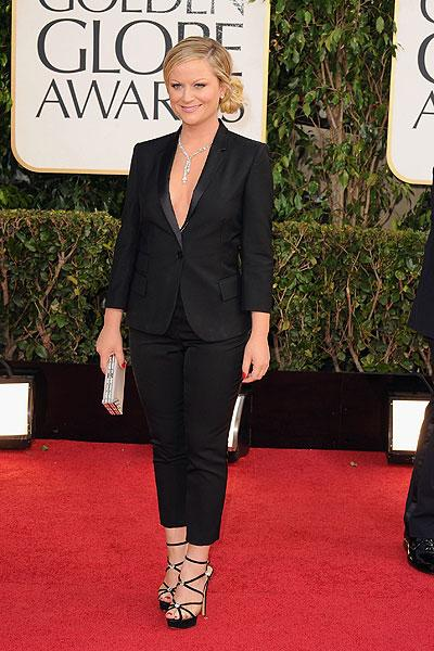 Amy Poehler: We're calling it: The Golden Globe co-host is one of the best dressed of the night. She puts a sexy twist on an  understated black men's look complete with a sexy blazer, Le Cigaratte pants, strappy stilettos and a diamond necklace. (Photo by Steve Granitz/WireImage)