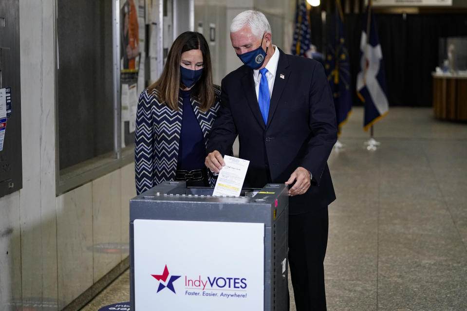Vice President Mike Pence and his wife Karen, cast their ballots during early voting in Indianapolis, Friday, Oct. 23, 2020. (AP Photo/Michael Conroy)
