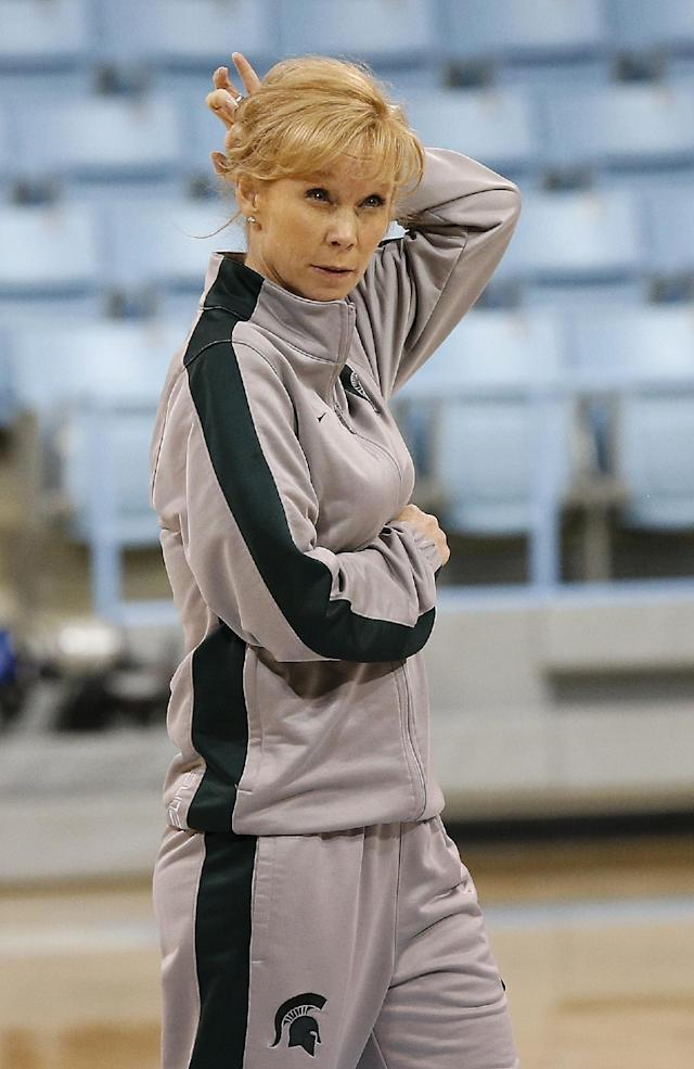 Michigan State head coach Suzy Merchant watches her team during practice at the NCAA women's college basketball tournament in Chapel Hill, N.C., March 22, 2014. Michigan State plays Hampton in a first-round game on Sunday. (AP Photo/Ellen Ozier)