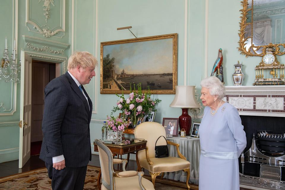 The Queen greets Boris Johnson at Buckingham Palace on Wednesday (PA)
