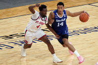 Seton Hall guard Jared Rhoden (14) drives against St. John's guard Greg Williams Jr. (4) during the first half of an NCAA college basketball game in the quarterfinals of the Big East conference tournament, Thursday, March 11, 2021, in New York. (AP Photo/Mary Altaffer)