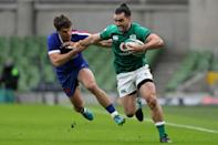 All-round game - France wing Damian Penaud, pictured chasing James Lowe (R) impressed in defence as well as attack against Ireland