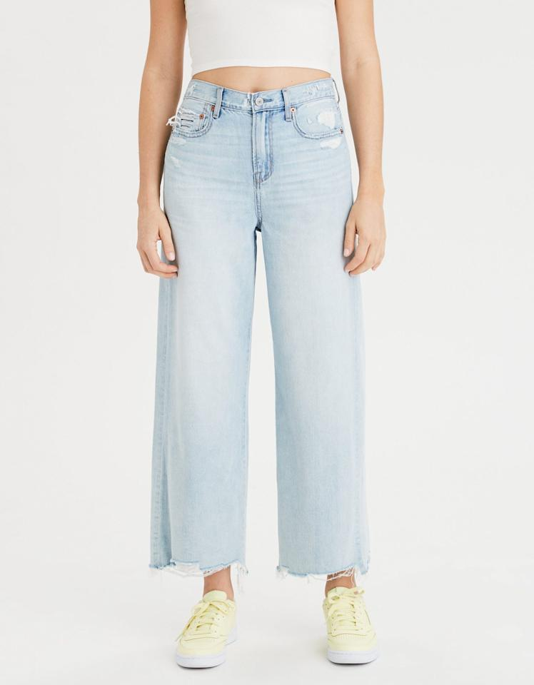 "<p><strong>Buy It!</strong> Wide Leg Crop Jeans in Emotional Blue, $49.95; <a href=""http://www.anrdoezrs.net/links/7799179/type/dlg/sid/PEO,TheBiggestSpringDenimTrends,sball1271,Sty,Gal,7741115,202003,I/https://www.ae.com/us/en/p/women/high-waisted-jeans/wide-leg-crop/wide-leg-crop-jean/2432_2502_136?menu=cat4840004"" target=""_blank"" rel=""nofollow"">ae.com</a></p>"