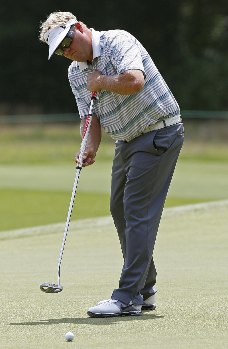 """FILE - In this Aug. 17, 2012, file photo, Carl Pettersson, of Sweden, putts on the first green during the second round of the Wyndham Championship golf tournament in Greensboro, N.C.  his first comments since golf officials proposed a new rule to ban the anchored stroke of long putters, Pettersson calls it a """"witch hunt"""" that makes him feel as though he is 16 years behind his peers. That's how long he has been using a long putter, and the Swede isn't about to change anytime soon. (AP Photo/Gerry Broome, File)"""