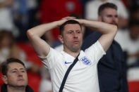 England fans react after Italy won the Euro 2020 soccer championship final match between England and Italy at Wembley stadium in London, Sunday, July 11, 2021. Italy defeated England 3-2 in a penalty shootout after the game ended in a 1-1 draw. (Carl Recine/Pool Photo via AP)