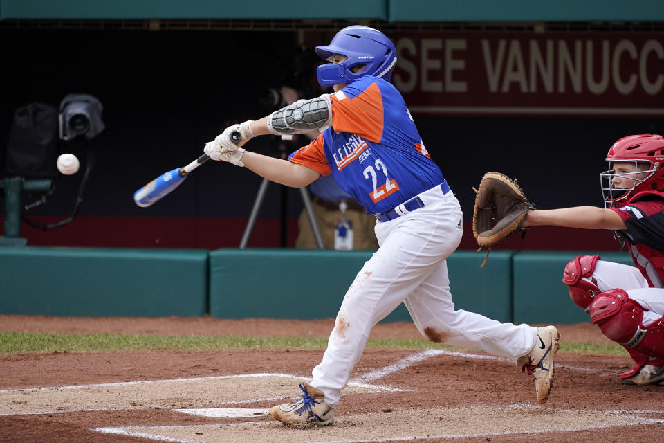 Taylor, Mich.'s Jackson Surma (22) hits a double off Hamilton, Ohio's Chance Retherford, driving in two runs, during the first inning of the Little League World Series Championship baseball game in South Williamsport, Pa., Sunday, Aug. 29, 2021. (AP Photo/Gene J. Puskar)