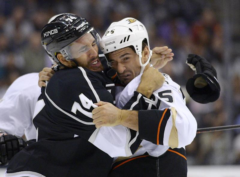 Los Angeles Kings center Dwight King, left, and Anaheim Ducks right wing Brad Staubitz fight during the first period of an NHL preseason hockey game, Tuesday, Sept. 24, 2013, in Los Angeles. (AP Photo/Mark J. Terrill)