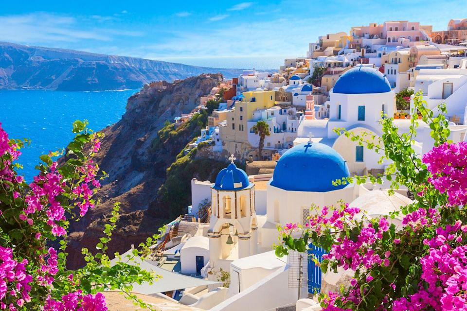 <p>White-washed villas, black sand beaches, and views of the blue Aegean Sea are a few of the reasons why this Greek island is just begging for couples to check it out.</p>