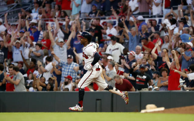 Atlanta Braves' Ozzie Albies rounds first base after hitting a three-run home run during the third inning of the team's baseball game against the Philadelphia Phillies on Thursday, July 4, 2019, in Atlanta. (AP Photo/John Bazemore)