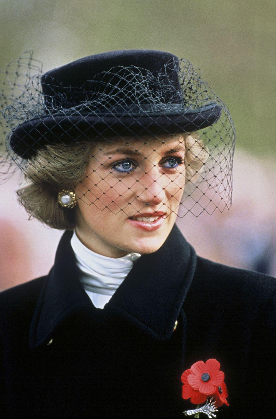 <p>Diana's fascinator game is regularly on-point, and this dark-hued hat and veil combo is no different.</p>
