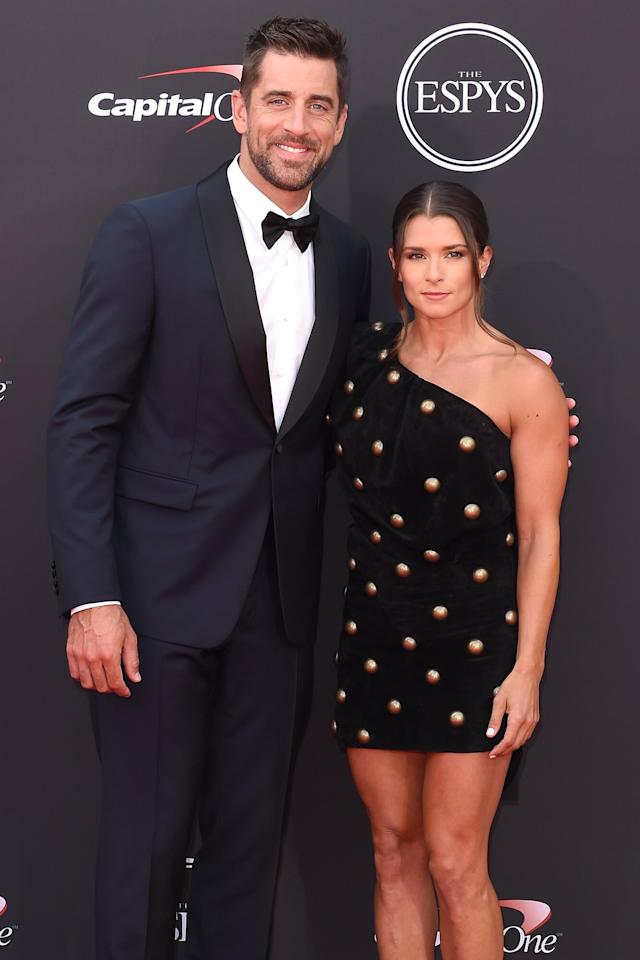 """The Green Bay Packers quarterback discussed his Christian upbringing and when <a href=""""https://people.com/sports/aaron-rodgers-opens-up-about-religion-to-danica-patrick-i-dont-know-how-you-can-believe-in-a-god/"""">he first began to question his faith</a> on girlfriend<a href=""""https://people.com/tag/danica-patrick/"""">Danica Patrick</a>'s <em>Pretty Intense</em> podcast.  """"Most people that I knew, church was just … you just had to go,"""" Rodgers recalled before diving into his experience after discovering other religions.  """"I started questioning things, and had friends who had other beliefs — I enjoyed learning, that's kind of a part of my life,"""" the Super Bowl XLV champion said.  """"I had some good friendships along the way that helped me to figure out exactly what I wanted to believe in,"""" he continued. """"Ultimately, it was that rules and regulations and binary systems don't really resonate with me.""""  This realization eventually led Rodgers down a path to a """"different type of spirituality,"""" he explained, before airing out his doubts, saying, """"I don't know how you can believe in a God who wants to condemn most of the planet to a fiery hell.""""  He added: """"What type of loving, sensitive, omnipresent, omnipotent being wants to condemn his beautiful creation to a fiery hell at the end of all this?"""""""