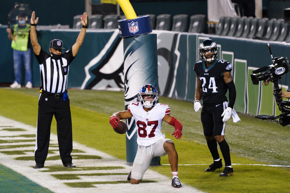 New York Giants wide receiver Sterling Shepard (87) celebrates after scoring a touchdown against Philadelphia Eagles' Darius Slay (24) during the second half of an NFL football game, Thursday, Oct. 22, 2020, in Philadelphia. (AP Photo/Chris Szagola)