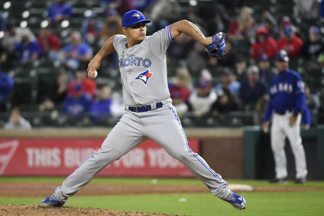 FILE - In this April 6, 2018, file photo, Toronto Blue Jays relief pitcher Roberto Osuna works against the Texas Rangers in the ninth inning of a baseball game in Arlington, Texas. Osuna has been charged with assault. Toronto police declined to say Tuesday, May 8, 2018, whether it was domestic assault. Const. Jenifferjit Sidhu says the charge is for one count of assault, and provided no further details.. (AP Photo/Jeffrey McWhorter, File)