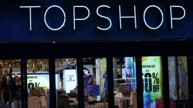 General view of a Topshop store logo, owed by Arcadia group on Oxford street in London