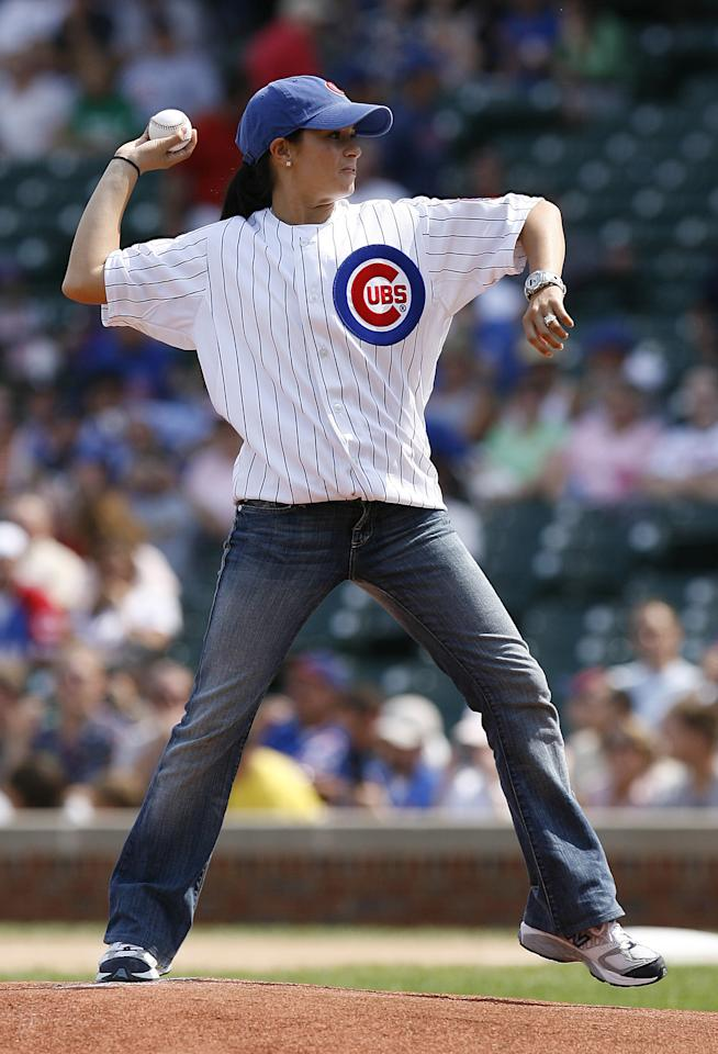 IRL driver Danica Patrick throws out the ceremonial first pitch before the baseball game between the Pittsburgh Pirates and Chicago Cubs at Wrigley Field, Thursday, Sept. 7, 2006 in Chicago.(AP Photo/Nam Y. Huh)