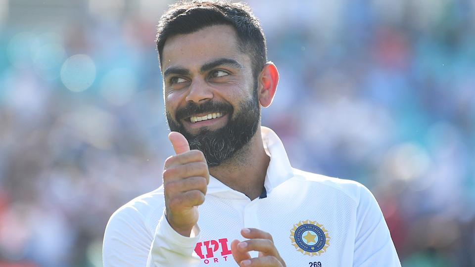Virat Kohli angered some English cricket fans with his mockery of the Barmy Army during India's fourth Test victory, but was defended by cricket great Michael Vaughan. (Photo by Gareth Copley/Getty Images)