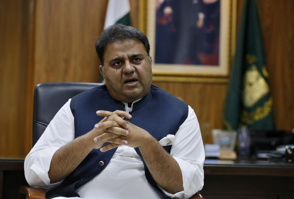 Pakistan's Information Minister Fawad Chaudhry speaks about violence against women during an interview with The Associated Press, in Islamabad, Pakistan, Tuesday, July 27, 2021. The beheading of a young woman in an upscale neighborhood of Pakistan's capital has shone a spotlight on the relentless violence against women in the country. Rights activists say such gender-based assaults are on the rise as Pakistan barrels toward greater religious extremism. (AP Photo/Anjum Naveed)