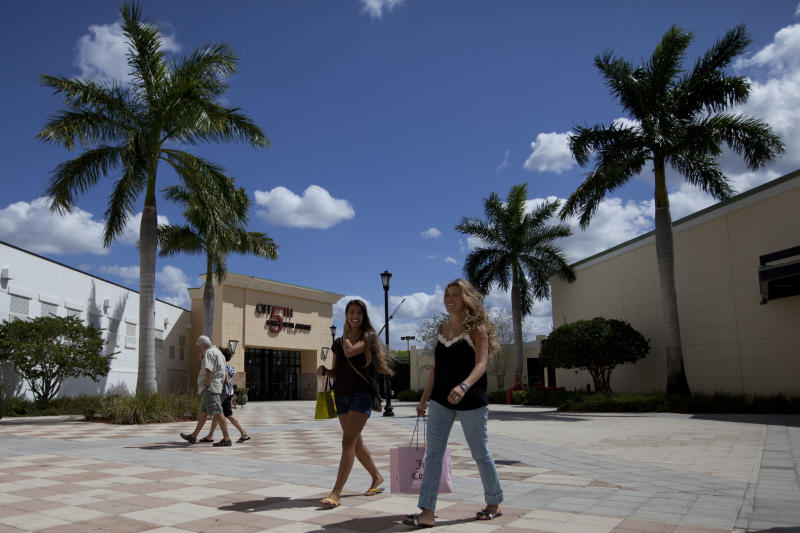 In this March 6, 2012 photo, Daniela Dias, right, and her sister Natalia, from Brazil, shop at the Sawgrass Mills mall in Fort Lauderdale, Florida. Brazilian travelers spend more per capita than any other visitors to the U.S. (AP Photo/Felipe Dana)