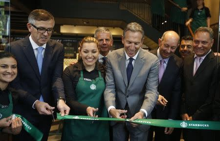 CEO of Starbucks Howard Schultz inaugurates the coffee chain's first Colombian store at 93 park in Bogota
