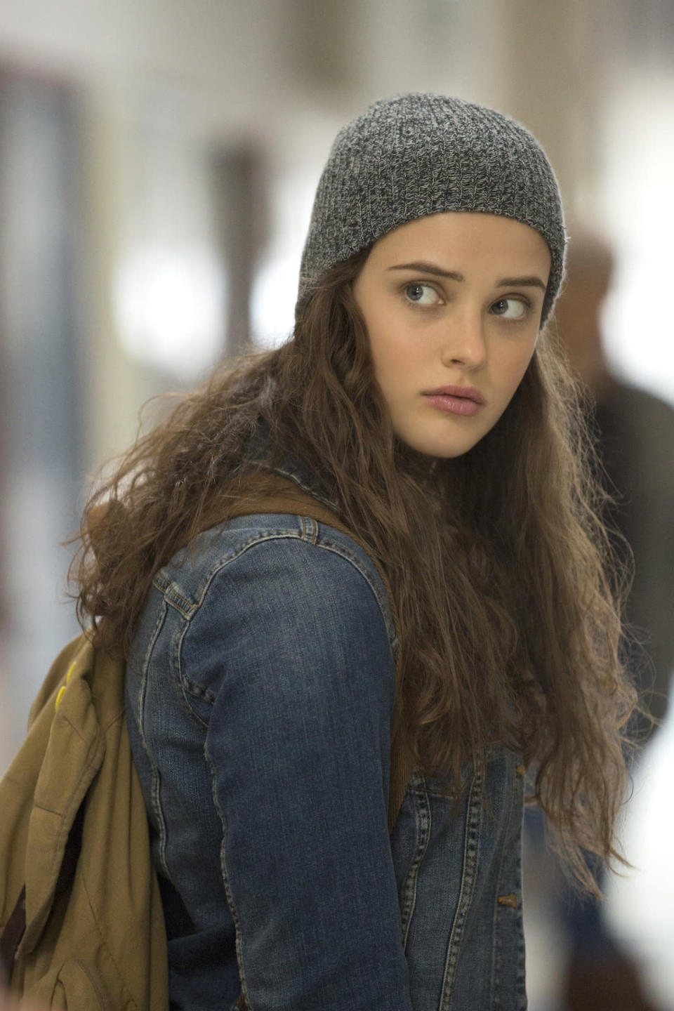 <p>The series' central character ends her life at age 17 when she is a junior in high school, leaving a heartbreaking, multi-part taped explanation as to why she checked out. We also see Hannah as a 16-year-old sophomore in flashbacks. (Photo: Netflix) </p>