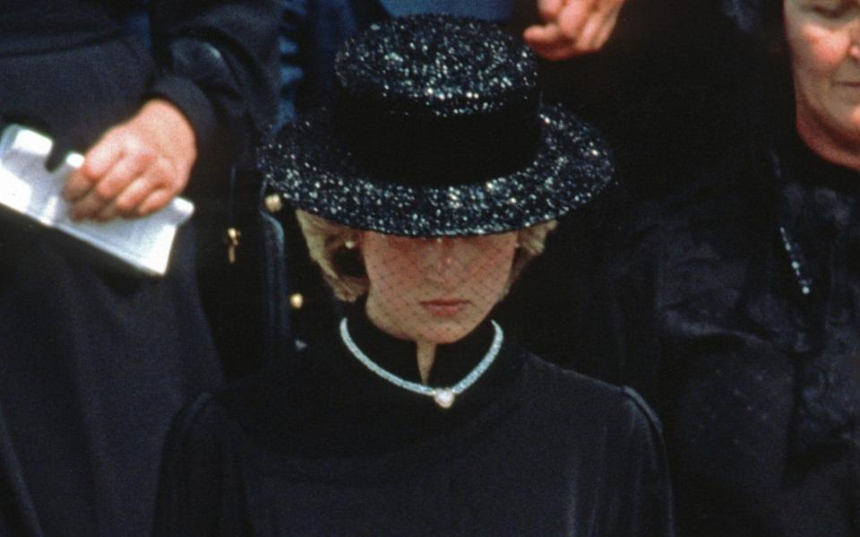 Diana, Princess of Wales, wearing a black dress and black boater hat with a netted veil and a heart shaped diamond necklace which was a gift from Prince Charles, Prince of Wales to mark the birth of Prince William, attends the funeral of Princess Grace of Monaco on September 18, 1982 in Monaco - Anwar Hussein/Getty