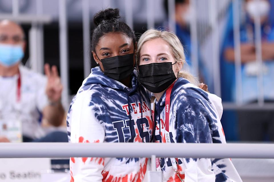 Simone Biles and MyKayla Skinner watch the Men's All-Around Final on day five of the Tokyo 2020 Olympic Games.