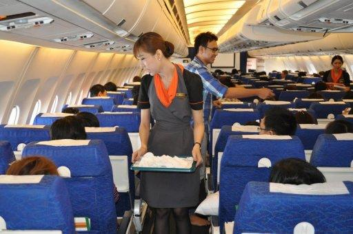 A transsexual fight attendant works onboard a Thai PC Air flight between Bangkok and Hong Kong