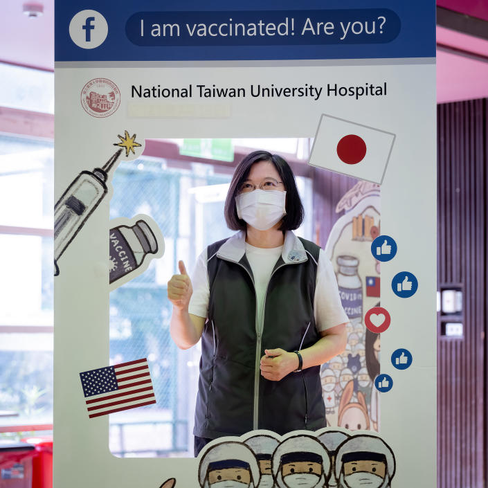 In this photo released by the Taiwan Presidential Office, Taiwanese President Tsai Ing-wen poses for a photo at the Taiwan University Hospital where she received her first shot of the island's first domestically developed coronavirus vaccine made by Medigen Vaccine Biologics Corp. at the in Taipei, Taiwan on Monday, Aug. 23, 2021. The vaccine was given emergency approval by regulators in July using a shortcut that prompted fierce opposition from parts of Taiwan's medical and scientific community. (Taiwan Presidential Office via AP)