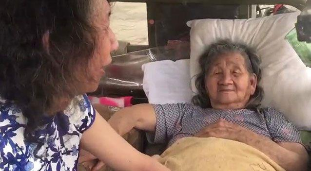 The video, which has gone viral across Chinese social media, shows the unnamed man wearing a traditional cheongsam dress while tending to his elderly mother. Picture: Pear Video