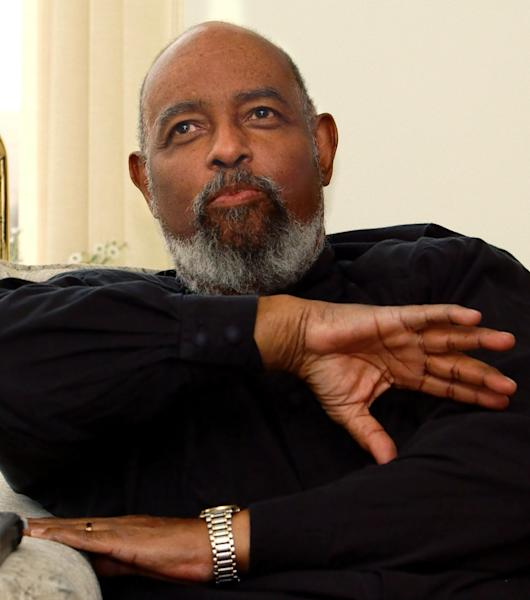 FILE - In this May 9, 2002 file photo, James DePreist, talks about his conducting career as he sits in his high rise apartment overlooking downtown Portland. One of the early African-American conductors of a major orchestra and National Medal of Arts winner James DePreist has died at age 76. His manager, Jason Bagdade, says DePreist died at home Friday, Feb. 8. 2013 in Scottsdale, Ariz. (AP Photo/Greg Wahl-Stephens)