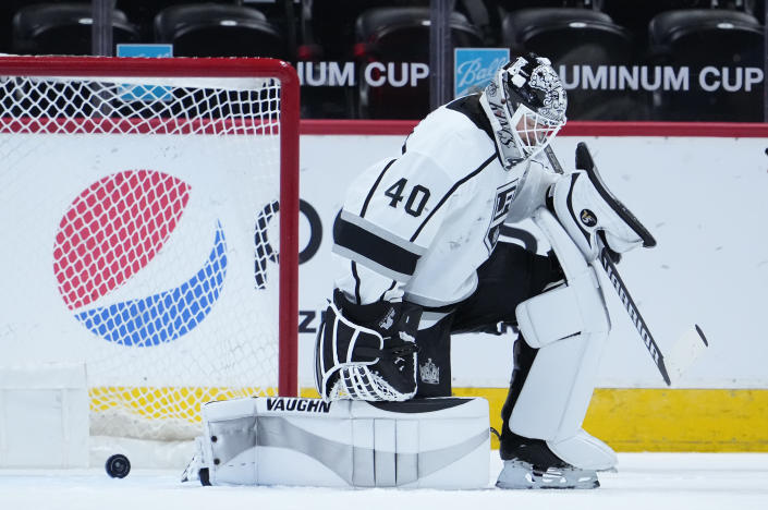Los Angeles Kings goaltender Calvin Petersen (40) reacts to letting the puck slip past for a goal off the stick of Colorado Avalanche left wing J.T. Compher (37) during the first period of an NHL hockey game Wednesday, May, 12, 2021, in Denver. (AP Photo/Jack Dempsey)