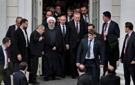 Iranian President Hassan Rouhani, Russian President Vladimir Putin and Turkish President Recep Tayyip Erdogan walk during their meeting in the Black sea resort of Sochi, Russia, 14 February 2019. Sergei Chirikov/Pool via REUTERS