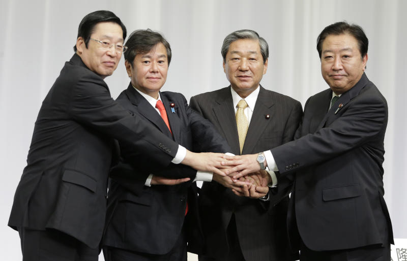 Japanese Prime Minister Yoshihiko Noda, right, puts hands together with former Agriculture, Forestry and Fisheries Minister Michihiko Kano, left, former Internal Affairs and Communications Minister Kazuhiro Haraguchi, second left, and former Agriculture, Forestry and Fisheries Minister Hirotaka Akamatsu during a joint press conference by candidates of presidential election of Japan's ruling Democratic Party of Japan in Tokyo Monday, Sept. 10, 2012. Noda will face three ruling party contenders in a leadership election later this month that he is expected to win. (AP Photo/Shizuo Kambayashi)