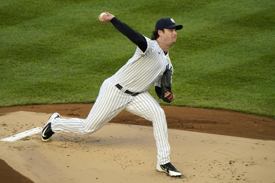 New York Yankees starting pitcher Gerrit Cole (45) winds up during the first inning of a baseball game against the Baltimore Orioles, Tuesday, April 6, 2021, at Yankee Stadium in New York. (AP Photo/Kathy Willens)