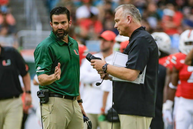 Miami head coach Mark Richt, right, and defensive coordinator Manny Diaz talk on the sidelines during the first quarter against Pittsburgh at Hard Rock Stadium in Miami Gardens, Fla., on Saturday, Nov. 24, 2018. The host Hurricanes won, 24-3. (Getty)