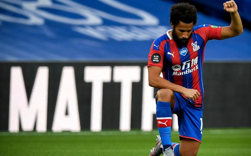 Crystal Palace's Andros Townsend kneels down to make a stand against racism prior to the English Premier League match between Crystal Palace and Burnley - Daniel Leal-Olivas/NMC/Pool/EPA-EFE/Shutterstock