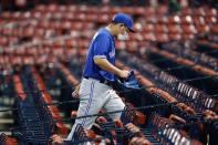 Toronto Blue Jays' Shun Yamaguchi leaves the field through the empty stands after the Blue Jays lost to the Boston Red Sox during a baseball game, Friday, Aug. 7, 2020, in Boston. (AP Photo/Michael Dwyer)