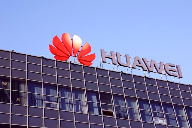 Moscow, Russia 30 August 2019 Huawei telecom company logo on office building against clear blue sky