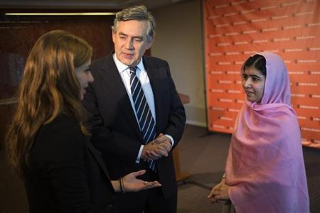 Brown stands between Yousafzai and Haddad at a news conference convened by 'A World at School' in New York