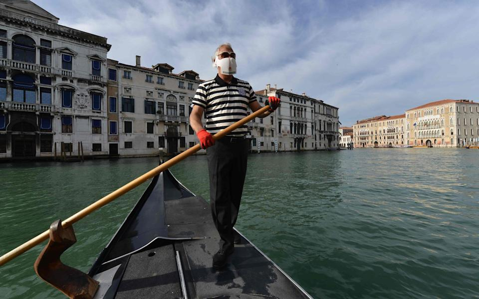 Gondolier in Venice - Getty