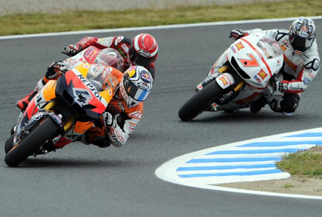 Andrea Dovizioso of Italy (L) rides his Honda during the Moto GP class qualifying practice session of the motorcycle Grand Prix of Japan at Twin Ring Motegi circuit in Motegi on October 1, 2011. Australian Moto GP world championship leader Casey Stoner will start on pole at the Grand Prix of Japan after recording the fastest time in qualifying on October 1.AFP PHOTO / TOSHIFUMI KITAMURA (Photo credit should read TOSHIFUMI KITAMURA/AFP/Getty Images)