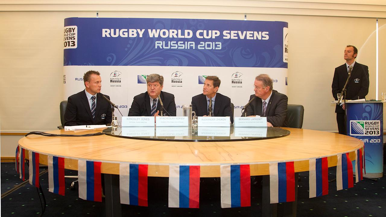 (From left) Kingsley Jones, National Team Director, Vyacheslav Kopiev, President of the Rugby Union Russia, Alexander Zhukov, Deputy President of Russia and Bernard Lapasset, Chairman of the IRB, speak during a Rugby Sevens announcement at the TSB Center in New Plymouth on  September 15, 2011. The 2013 IRB Rugby Sevens Tournament will be held in the Russian city of Moscow. AFP PHOTO / Marty Melville (Photo credit should read Marty Melville/AFP/Getty Images)