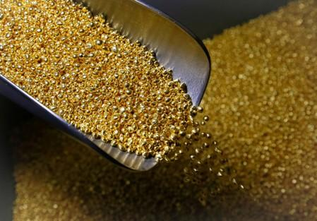 Gold dips on profit-taking, trade uncertainties cap losses