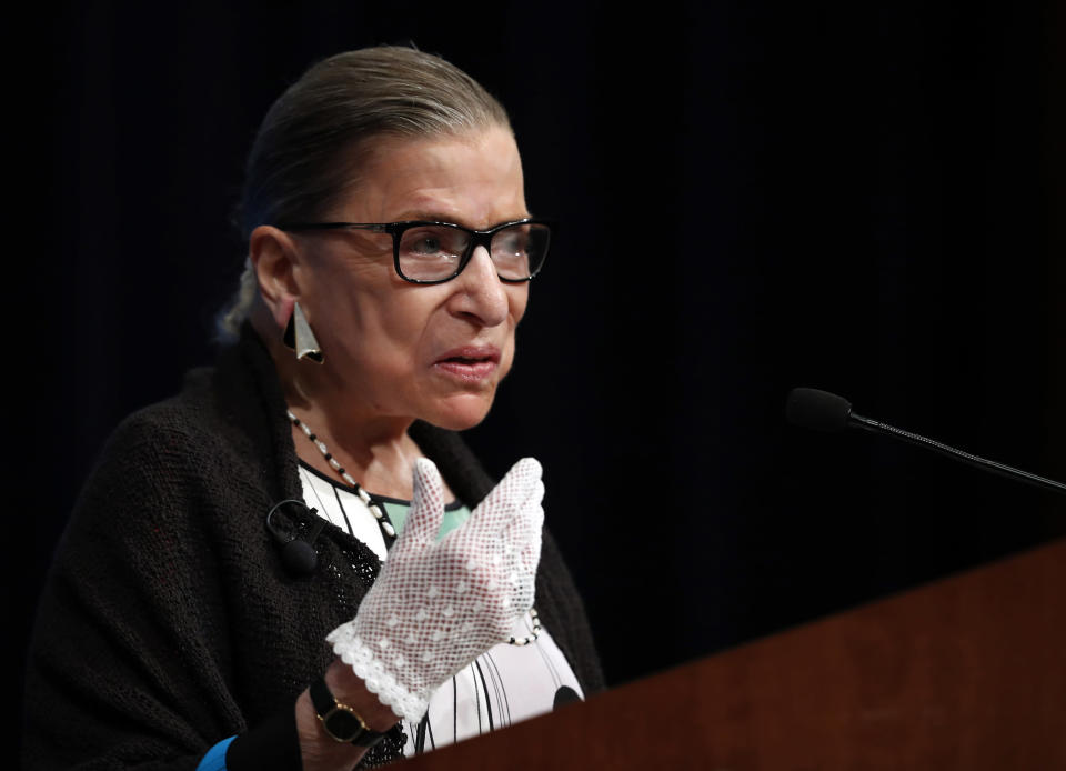 FILE - This Sept. 20, 2017, file photo shows Supreme Court Justice Ruth Bader Ginsburg speaking at the Georgetown University Law Center campus in Washington. Ginsburg didn't put on her judge's robe without also fastening something around her neck. Ginsburg called her neckwear collars, or jabots, and they became part of her signature style, along with her glasses, lace gloves and fabric hair ties known as scrunchies. (AP Photo/Carolyn Kaster, file)