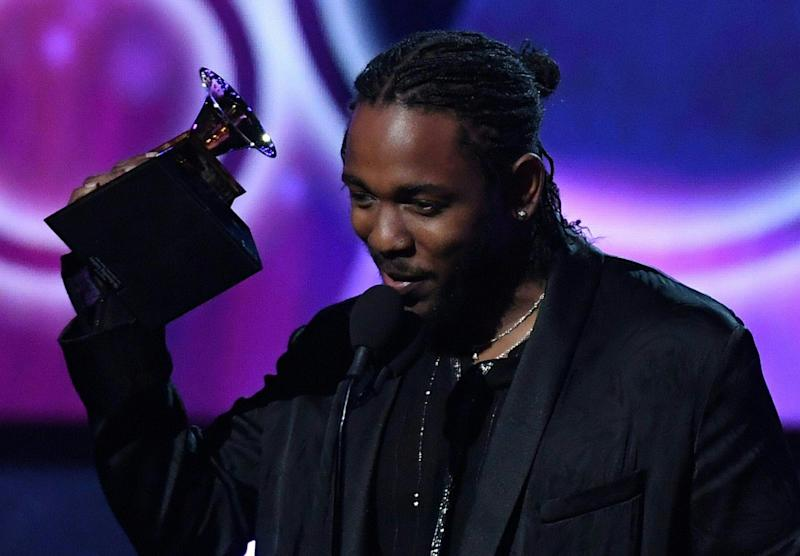 """Kendrick Lamar receives the Grammy for the Best Rap Album with """"Damn"""" during the 60th Annual Grammy Awards show on Jan. 28, 2018, in New York. (TIMOTHY A. CLARY via Getty Images)"""