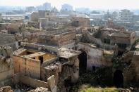 A view of the old city of Mosul and buildings destroyed during past fighting with Islamic State militants