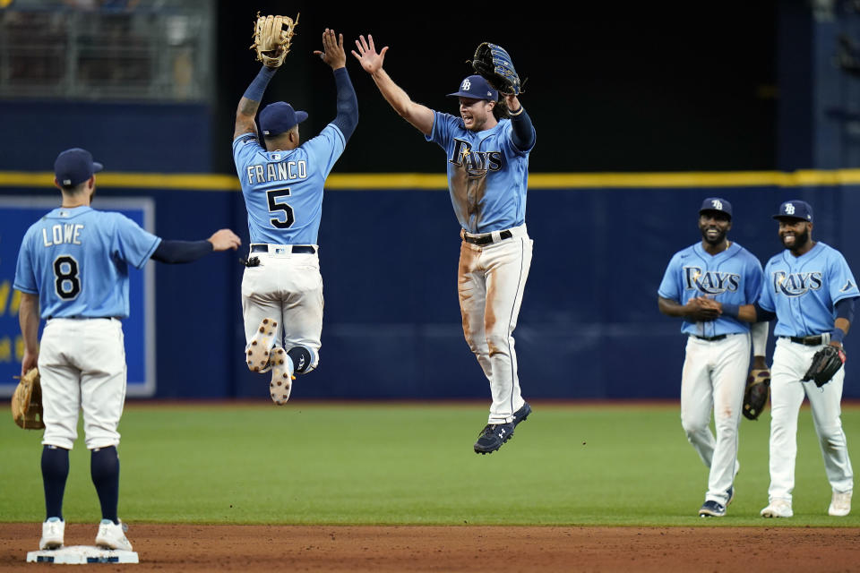 Tampa Bay Rays shortstop Wander Franco (5) and center fielder Brett Phillips celebrate with teammates after defeating the Boston Red Sox during a baseball game Wednesday, June 23, 2021, in St. Petersburg, Fla. (AP Photo/Chris O'Meara)