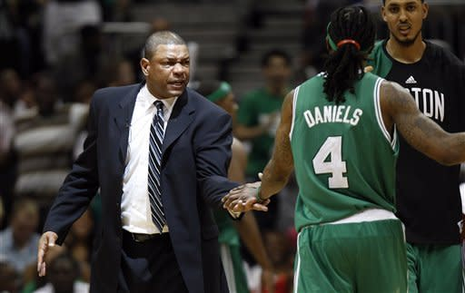 Boston Celtics coch Doc Rivers greets Marquis Daniels as he leaves the court during a timeout in the second half of Game 2 of an NBA first-round playoff basketball series against the Atlanta Hawks on Tuesday, May 1, 2012, in Atlanta. Boston won 87-80 and evened the series at one game each. (AP Photo/John Bazemore)