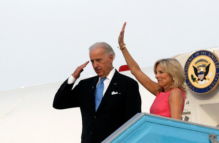 U.S. Vice President Joe Biden (L) and his wife Jill gesture before boarding a plane at Ben Gurion International airport near Tel Aviv March 11, 2010. Biden called on Thursday for Israeli-Palestinian peace talks to start without delay despite Palestinian insistence that Israel first cancel a settlement project condemned by Washington.